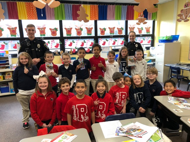 Officer Dunn and Officer Strenkoski from Taylor Police Department speak to 2nd Grade students